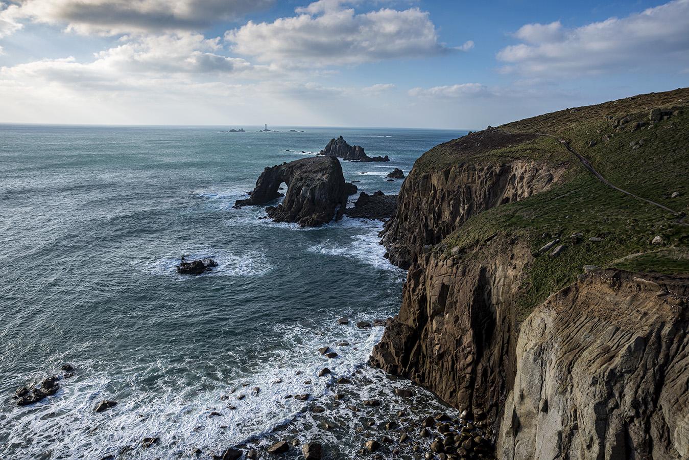 Coastal walk past Enys Dodnan Arch - Land's End